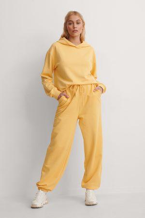 NA-KD Organic Oversized Drawstring Sweatpants - Yellow