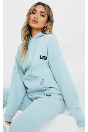PRETTYLITTLETHING Petite Sage Badge Detail Oversized Hoodie