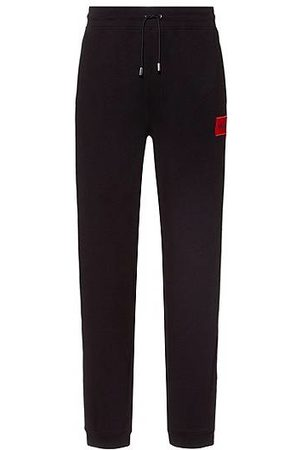 HUGO BOSS Cotton-terry tracksuit bottoms with red logo label