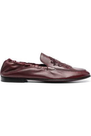Dolce & Gabbana Debossed-motif polished-finish loafers