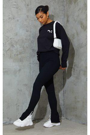 PRETTYLITTLETHING Black Textured Ribbed Split Hem Leggings