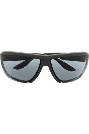 Prada Wraparound tinted sunglasses