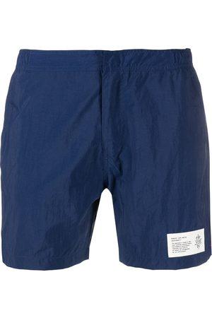ELEVENTY Logo-patch swim shorts