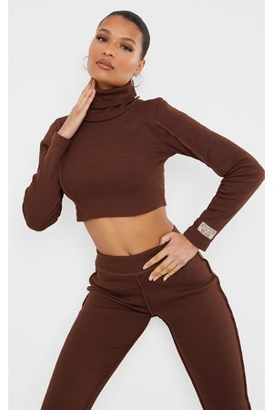 PRETTYLITTLETHING Chocolate Badge Structured Rib High Neck Long Sleeve Crop Top