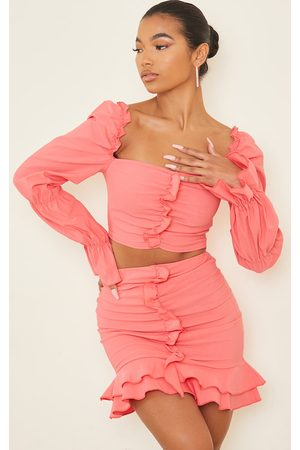 PRETTYLITTLETHING Women Crop Tops - Coral Woven Frill Stretch Ruched Front Long Sleeve Crop Top