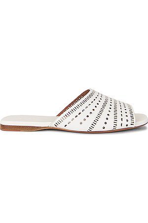 Alaïa Vienne Leather Slides in Blanc Craie