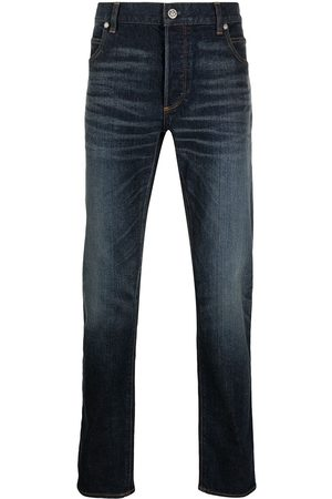 Balmain Embroidered-logo tapered jeans