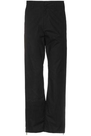 MARCELO BURLON TROUSERS - Casual trousers