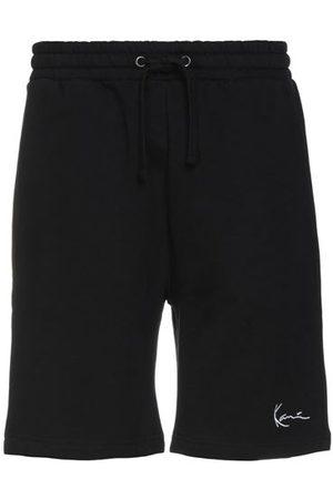 Karl Kani TROUSERS - Bermuda shorts