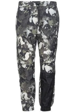 MARCELO BURLON TROUSERS - Casual trousers