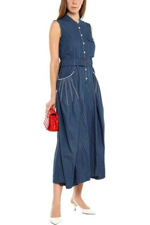 HIGH DUNGAREES - Jumpsuits