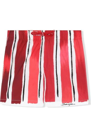 Dolce & Gabbana Kids Paint-effect striped swim shorts