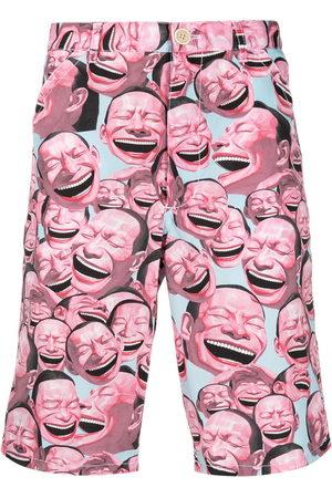 Comme des Garçons Laughter print shorts