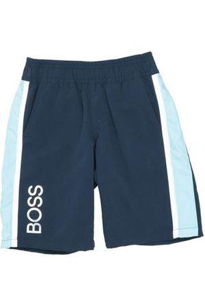 HUGO BOSS TROUSERS - Bermuda shorts