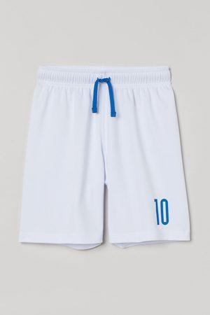 H & M Football shorts