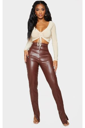 PRETTYLITTLETHING Shape Chocolate PU Seam Detail Split Hem Leggings