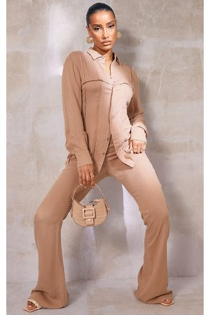 PRETTYLITTLETHING Camel Textured Stripe Pocket Flared Trousers