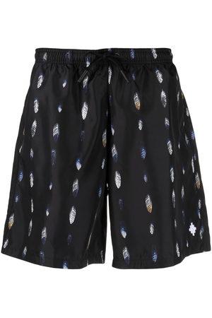 MARCELO BURLON Men Swim Shorts - Feather-print swim shorts