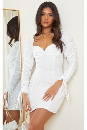 PRETTYLITTLETHING Cream Woven Ruched Cup Detail Long Sleeve Bodycon Dress