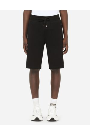 Dolce & Gabbana Men Trousers - Trousers and Shorts - JERSEY JOGGING SHORTS WITH BRANDED PLATE male 46