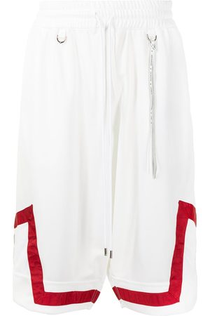 MASTERMIND Stripe-print knee-length shorts