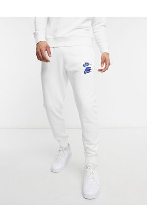 Nike World Tour Pack graphic cuffed joggers in