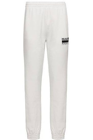 HUGO BOSS Women Sports Trousers - Relaxed-fit tracksuit bottoms in Recot2® French terry cotton