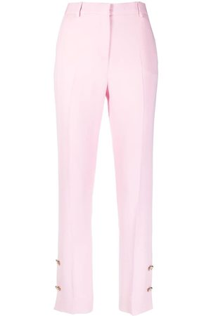 VERSACE Button-embellished skinny trousers