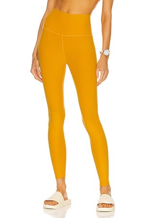 Beyond Yoga Spacedye Caught in the Midi High Waisted Legging in Sunny Citrine Solid