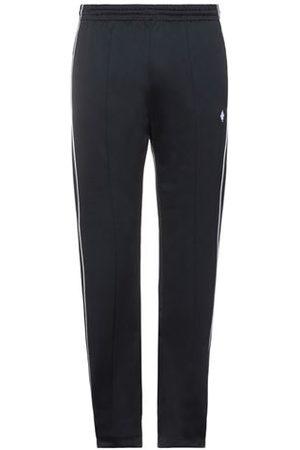 MARCELO BURLON Men Trousers - TROUSERS - Casual trousers