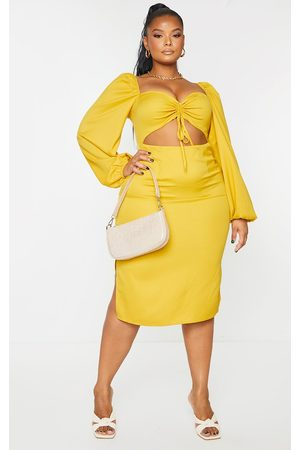 PRETTYLITTLETHING Plus Mustard Cut Out Ruched Bust Puff Sleeve Midi Dress