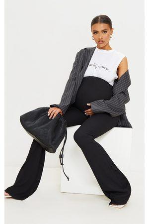 PRETTYLITTLETHING Maternity Ribbed Flared Leggings