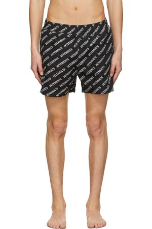 VETEMENTS Black All-Over Logo Swim Shorts