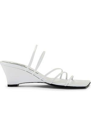 Reike Nen 5 Strap Wedge Heels in . Size 36, 37, 38, 39, 40.