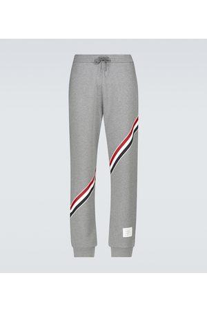 Thom Browne Men Sports Trousers - Sweatpants with diagonal stripe