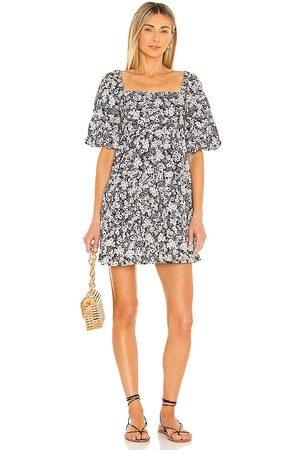 FAITHFULL THE BRAND Eryn Mini Dress in . Size XS, S, M, XL.