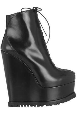 Alaïa Women Ankle Boots - FOOTWEAR - Ankle boots