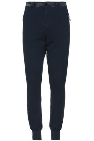 FRANKIE MORELLO Men Trousers - TROUSERS - Casual trousers
