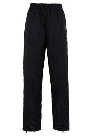 NIKE Women Trousers - TROUSERS - Casual trousers