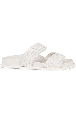 Alaïa Leather Slides in Blanc Casse