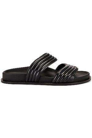 Alaïa Leather Slides in Noir