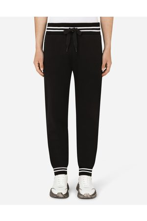 Dolce & Gabbana Men Trousers - Trousers and Shorts - Jersey jogging pants with branded plate male 44