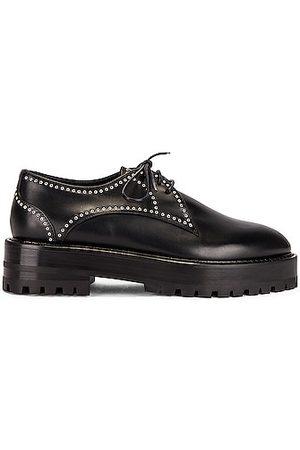 Alaïa Eyelet Derby Loafers in Noir