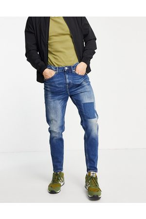 New Look Tapered jeans in wash