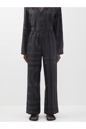 Totême Monogram-embroidered Silk-twill Pyjama Trousers - Womens