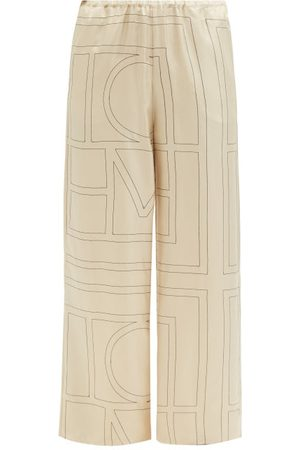 Totême Monogram-embroidered Silk-twill Pyjama Trousers - Womens - Cream