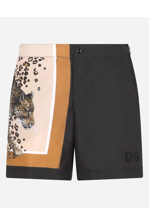Dolce & Gabbana Men Swim Shorts - Collection - Mid-length swim shorts with leopard print and DG logo male 44