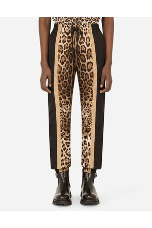 Dolce & Gabbana Trousers and Shorts - Jogging pants with leopard-print inserts male 48