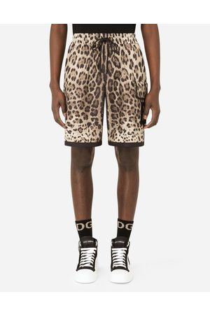 Dolce & Gabbana Trousers and Shorts - Leopard-print nylon shorts with DG patch male 48