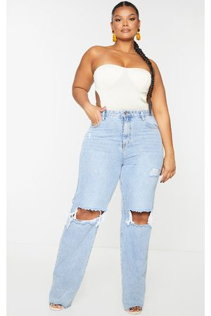 PrettyLittleThing Plus Cream Strapless Cut Out Plisse Top